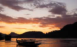 Colorful sunset on Mekong river with close up view of traditiona Stock Photography