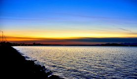 Colorful sunset. Mother Nature providing a colorful sunset at Alki Beach in Washington Stock Photography