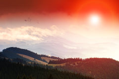 Colorful sunset in the mountains. Dramatic overcast sky Royalty Free Stock Photography