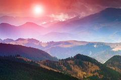 Colorful sunset in the mountains. Dramatic overcast sky Royalty Free Stock Photo