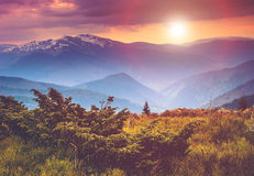 Colorful sunset in the mountains landscape.Dramatic overcast sky. Stock Image