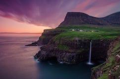 Colorful sunset at the Mulafossur water by village Gasadalur, Vagar island, Faroe Islands