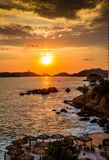 Colorful sunset over Acapulco bay.CR2. Colorful sunset over coastline of Acapulco bay royalty free stock image