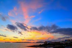 Colorful sunset over Alghero shoreline Stock Photos