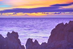 Colorful sunset over Atlantic Ocean. Sunset seascape - Tenerife, The Canaries. Water in motion blur Royalty Free Stock Image