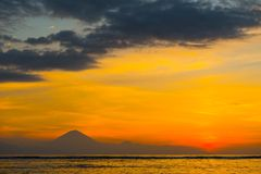 Colorful sunset over Bali. Colorful sunset over Pacific Ocean with Bali island on horizon Stock Photos