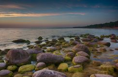 Colorful sunset over Baltic sea. Travel in Latvia - Baltic sea sunset on rock beach Royalty Free Stock Photo