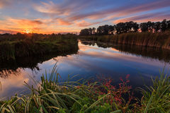 Colorful sunset over the beautiful river Stock Images