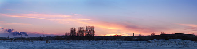 Colorful sunset over blue snow field. Colorful sunset over the blue snow field Stock Photos