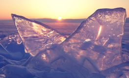 Colorful sunset over the crystal ice of Baikal lake Royalty Free Stock Photo