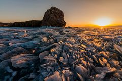 Colorful sunset over the crystal ice of Baikal lake Stock Photo