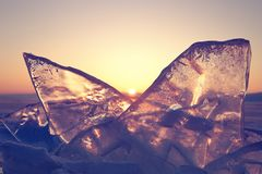 Colorful sunset over the crystal ice of Baikal lake royalty free stock photography