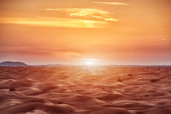 Colorful sunset over desert. Colorful red sunset over desert stock photos