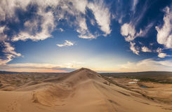 Colorful sunset over the dunes of the Gobi Desert. Royalty Free Stock Photo