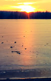 Colorful sunset over frozen lake Royalty Free Stock Photography