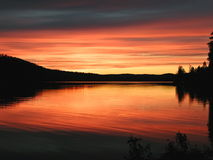 Colorful sunset over lake Stock Images
