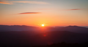 Colorful sunset over the mountain Stock Photography