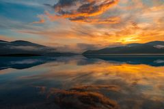 Colorful sunset over a mountain lake Stock Photo