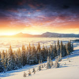 Colorful sunset over the mountain ranges in the national park Stock Images