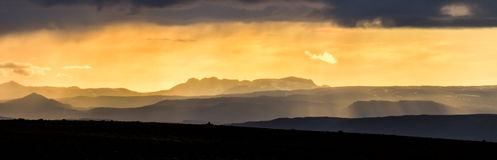 Colorful sunset over mountains. Fantastic view of icelandic landscape. Iceland. Colorful sunlight sunset over the mountains. Amazing view of the landscape in Royalty Free Stock Photo