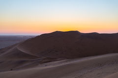Colorful sunset over the Namib desert, Namibia, Africa. Scenic sand dunes in backlight in the Namib Naukluft National Park, Swakop Royalty Free Stock Images