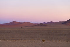Colorful sunset over the Namib desert, Namibia, Africa. Scenic sand dunes in backlight in the Namib Naukluft National Park, Swakop Stock Image