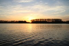 Colorful sunset over river Rotte in Zevenhuizen with reflection in the water in the Netherlands Stock Photography
