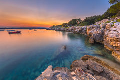 Colorful sunset over the rocky coast of Croatia Royalty Free Stock Images
