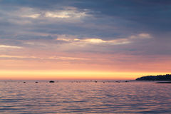 Colorful sunset over sea coast. Gulf of Finland Stock Images