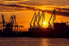 Sunset over sea port and industrial cranes, Varna royalty free stock image