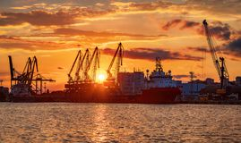 Sunset over sea port and industrial cranes, Varna stock photography