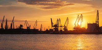 Sunset over sea port and industrial cranes, Varna stock image