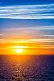 Colorful sunset over sea water Stock Images