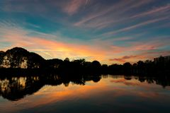 Colorful sunset over a small lake in The Netherlands stock photos