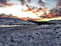 Sunset over a snowy mountain. Colorful sunset over a snowy field on top of a mountain pass in Colorado, USA stock photos