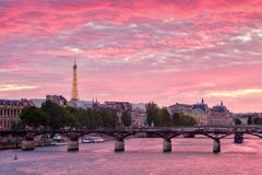 Colorful sunset in Paris. With a panoramic view of river Seine and the city stock photography
