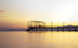 Colorful Sunset and a pier with long exposure.  Stock Image