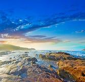 Colorful sunset in Porto Ferro Stock Photos