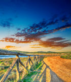 Colorful sunset by Porto Ferro shoreline. Shot in Sardinia, Italy Stock Photography