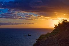 Colorful sunset on Portuguese island of Madeira. View from Funchal city royalty free stock image
