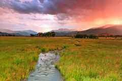 Colorful sunset rain above a stream in Heber Valley. Stock Images