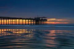 Sandy ripples reflecting sunset colors stock photos