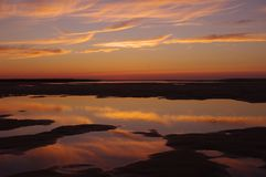 Reflected Sunset over tidal pools Royalty Free Stock Image