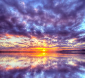 Colorful sunset reflected in the water Stock Images