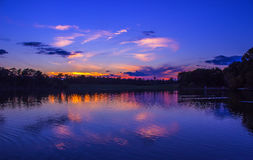 The Colorful Sunset Reflection. Photo taken at Cooper Creek Park, located in Columbus, Georgia royalty free stock image