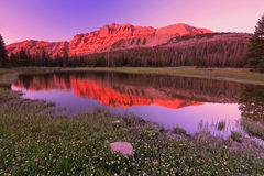 Colorful sunset reflection in the Utah mountains. Stock Photo