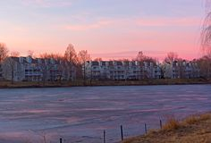 Pastel colors of winter sunset at lake waterfront in Falls Church, Virginia, USA. Royalty Free Stock Photography