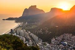 Colorful Sunset in Rio de Janeiro City. View of Sao Conrado During Beautiful Colorful Sunset Behind Mountains of Rio de Janeiro, Brazil Stock Photos