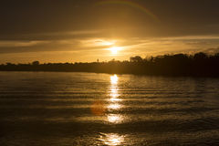 Colorful sunset on the river Amazon in the rainforest, Brazil Stock Image
