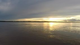 Colorful sunset on the river Amazon in the rainforest, Brazil stock video footage